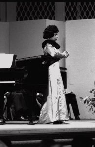 """Marian Anderson, the first African American soloist ever to perform at the Metropolitan Opera House, sings """"Ave Maria"""" on the stage of Carnegie Hall, in what was billed as her farewell performance, April 18, 1965. (AP photo/Dave Pickoff)"""